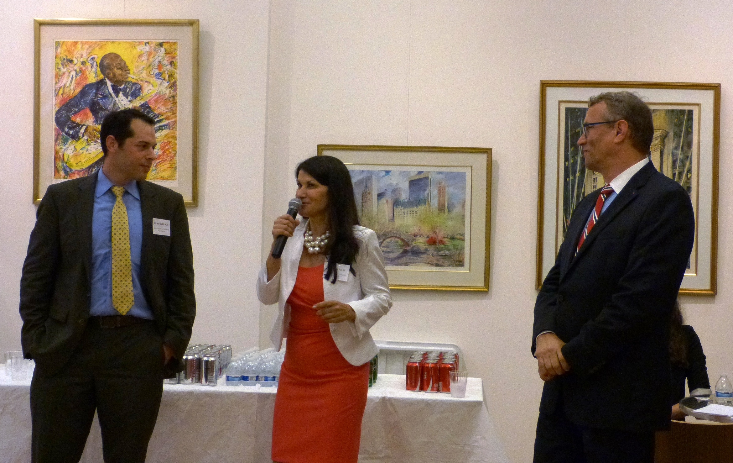 From left to right: Dr. Bruce Gelb, Dr. Ana Lita, and the Consul General of the Czech Republic, Mr. Martin Dvorak, give opening remarks at a cocktail party at Bohemian National Hall, kicking off the start of the Global Bioethics Initiative Summer School.