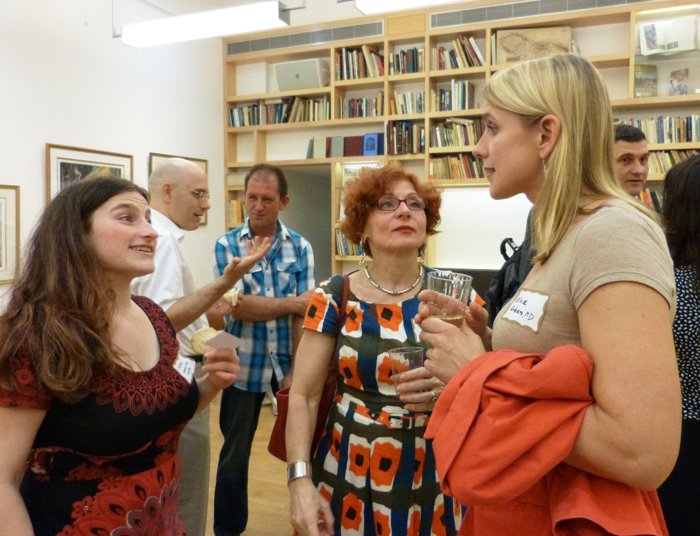 On the right, Dr. Nina Urban, GBI Board Member and Assistant Professor of Clinical Psychiatry at Columbia University, speaks with Summer School student Anna Nemeckova-Gulack (left) and her mother Mrs. Nemeckova (middle).