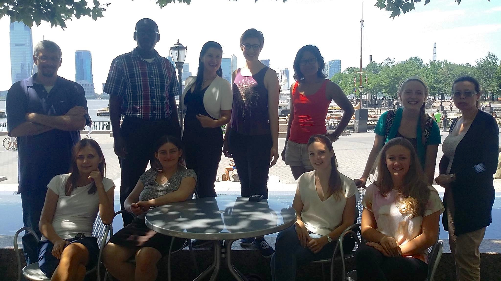 Summer school students and Ana Lita enjoy each others company near the One World Trade Center on a beautiful day