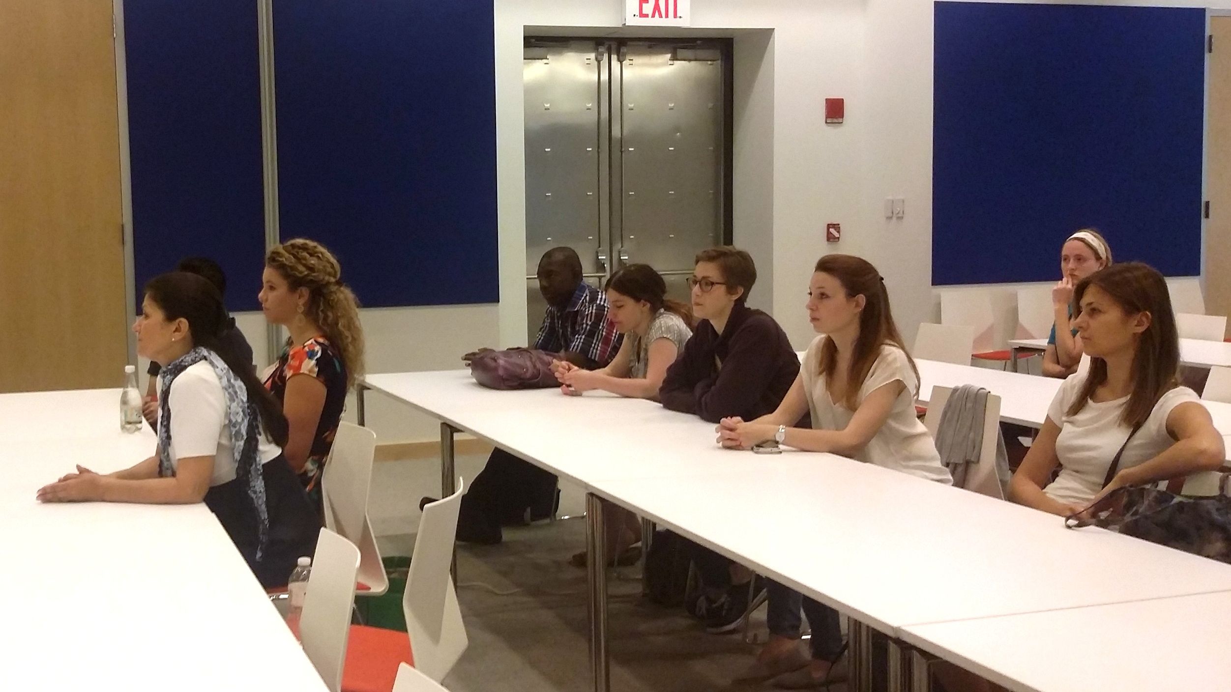 Summer school students listen to New York Genome Center employees discuss their jobs and the ethics behind genomic sequencing.