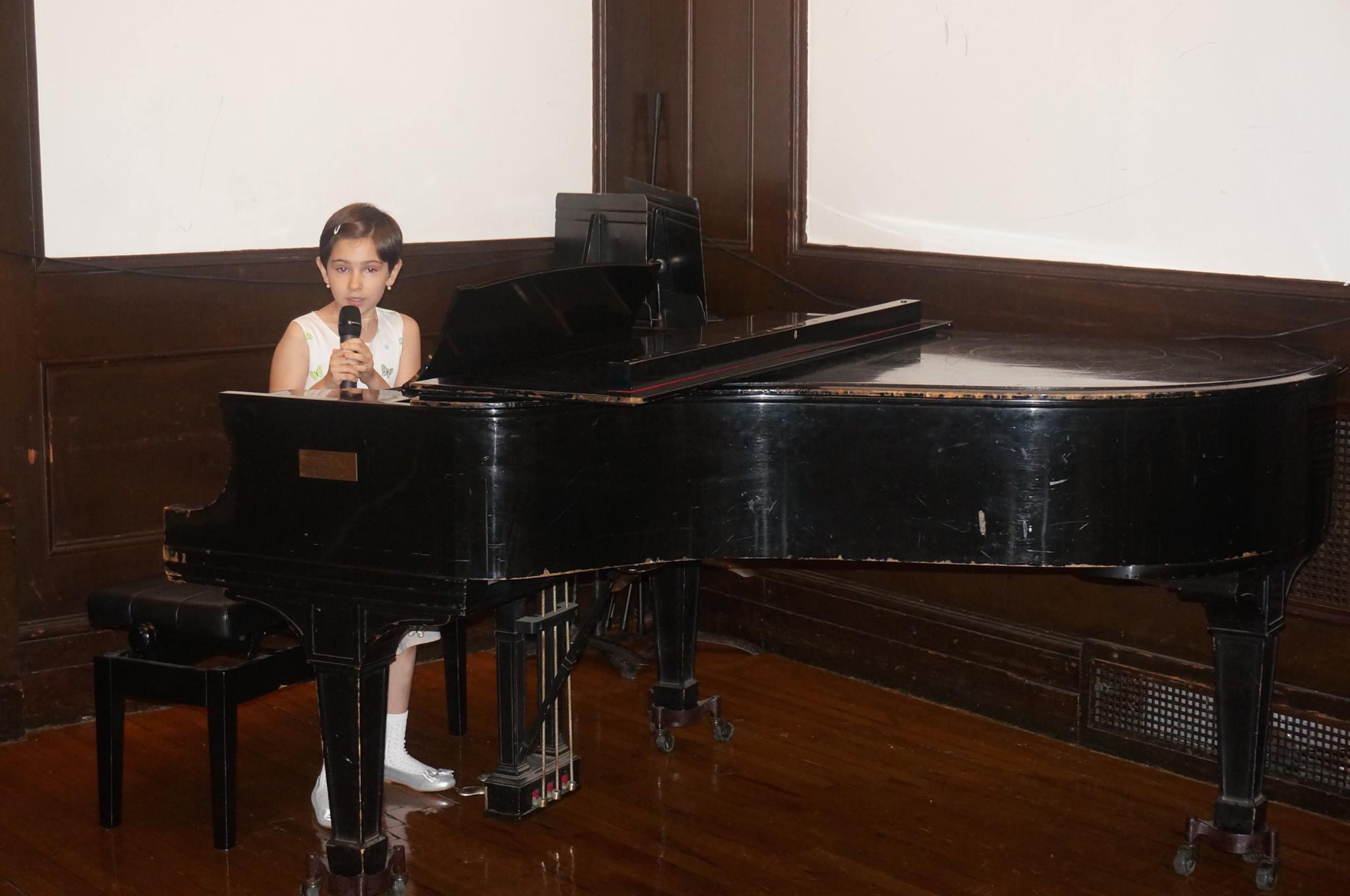 Carla Costache preforming a piano piece